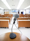 Microphone at podium. On seminar conference royalty free stock image