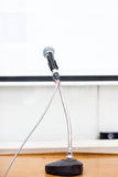 Microphone at podium. On seminar conference royalty free stock photography