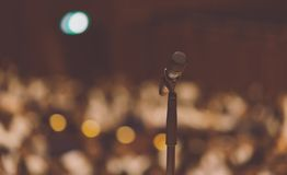 Microphone on the podium in conference hall. Microphone on the podium in seminar or conference hall stock photography