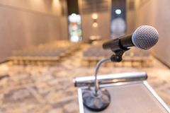 Microphone on the podium. In the seminar room royalty free stock images