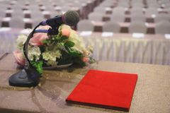 The microphone on podium stand at the center of the room to prep. The microphone is located on podium stand at the center of the room is covered with a red stock photo