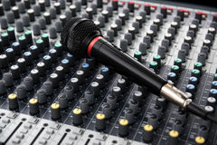 Microphone on a professional sound mixing console with adjusting Royalty Free Stock Images