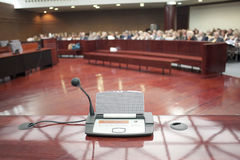 Microphone at prosecution. Microphone in the court room stock photography