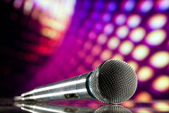 Microphone on purple background Royalty Free Stock Image