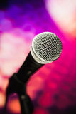 Microphone on purple background stock photo