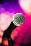 Microphone on purple background Stock Photo