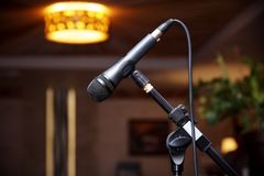 Microphone on the rack close-up. On a blurred background stock image