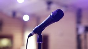 Microphone Standing On A Scene. Microphone on the rack in the concert stage stock footage