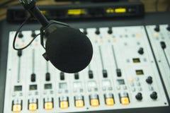 The microphone in the radio Studio. Audio console and microphone in the radio Studio Stock Photo