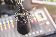 Microphone in radio studio. And background royalty free stock image