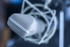 Microphone ready for recording in soundproofed room royalty free stock photography