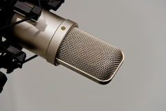 Microphone In Recording Studio. Professional condenser microphone in a studio environment stock image