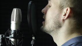 Microphone in a recording studio. Record a song or record a voiceover stock video