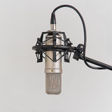 Microphone In Recording Studio. Professional condenser microphone in a studio environment royalty free stock photos