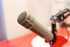 Microphone at recording studio or radio station. Technology, electronics and audio equipment concept - close up of microphone at recording studio or radio stock images