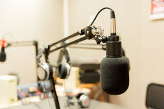 Microphone at recording studio or radio station. Technology, electronics and audio equipment concept - close up of microphone at recording studio or radio stock photography