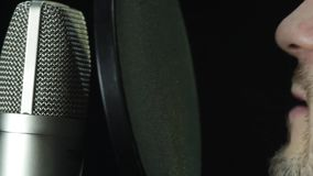 Microphone in a recording studio. Record a song or record a voiceover stock video footage