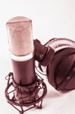 Microphone in recording studio on a white background. Royalty Free Stock Photography
