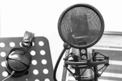 Studio dubbing and dubbing of feature films and TV shows. Microphone in the recording studio. Workplace announcer on television and in movies. Voice acting and royalty free stock images