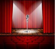 Microphone and red curtain Stock Photography