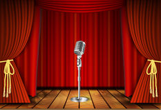 Microphone and red curtain Stock Images