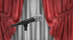 Microphone and red curtains. Microphone on stand, red and white curtains on background Royalty Free Stock Image
