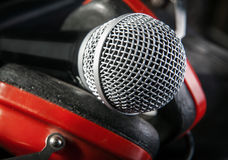 Microphone between red headphones, close-up Royalty Free Stock Image