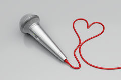 Microphone and red heart Stock Photography
