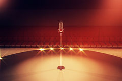 Microphone on red stage Stock Image