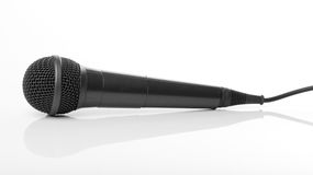 Microphone on reflecting background. Black semi-professional microphone lying on a reflecting background Royalty Free Stock Photography