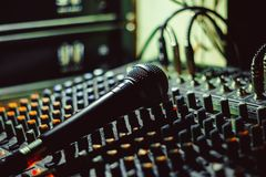 The microphone lies on the mixer Royalty Free Stock Photography