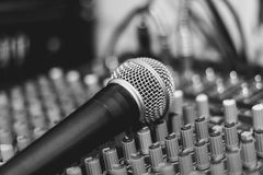 The microphone lies on the mixer Stock Photos