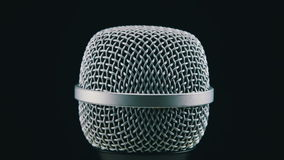 Microphone Rotates on a Black Background Stock Photography