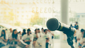 Microphone in seminar event , process in vintage style. Microphone in seminar event defocus on person background , process in vintage style Royalty Free Stock Images