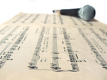 Microphone on sheet music Stock Images
