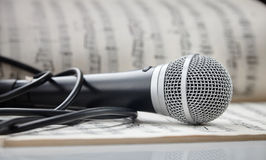 Microphone on sheet music Royalty Free Stock Image