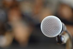 Microphone. Silver microphone on the podium for those who will be the speakers at the conference stock images