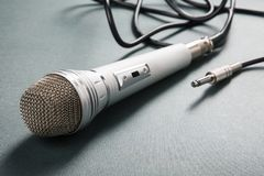 Microphone silver with a wire. On a ridge background royalty free stock images
