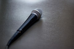 Microphone on sofa background Stock Image