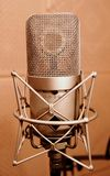 Microphone in a sound enclosure booth Stock Photo