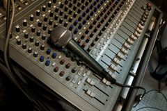 Microphone on sound mixer background. Stock Photo