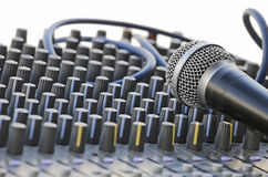 Microphone on the sound mixer. Isolated over white Royalty Free Stock Photos