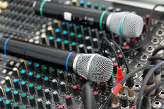Microphone and sound mixer in public area concert stage. The bright day. Concert or event on the street Royalty Free Stock Photos
