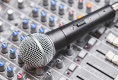 Microphone on sound mixing console Royalty Free Stock Images