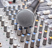 Microphone on sound mixing console Royalty Free Stock Photography