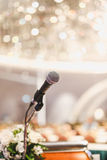 Microphone on the speech podium over the Abstract of conference. Hall or seminar room with attendee and bokeh, Business meeting concept royalty free stock photography