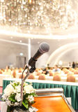 Microphone on the speech podium over the Abstract of conference. Hall or seminar room with attendee and bokeh, Business meeting concept stock images