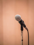 Microphone in spotlight Stock Photography