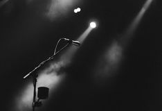 Microphone and spotlight on stage Royalty Free Stock Images