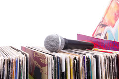 Microphone on stack of records. Closed-up stock photos